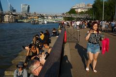 London (jaumescar) Tags: london england unitedkingdom thames river voyeur street photo woman walking skyline water binoculars light urban city