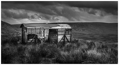 The Lonely Wagon (Ian Emerson) Tags: yorkshire dales moody blackwhite wagon rusting abandoned sky clouds framed vegetation canon hills hiking coast2coast