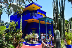 Le Jardin Majorelle, Marrakech (The_Kevster) Tags: morocco marrakech villa blue jardinmajorelle gardens majorelleblue yellow africa museum nikon dslr nikond3300 park cacti people touists sky light shadows artdeco trees plants building