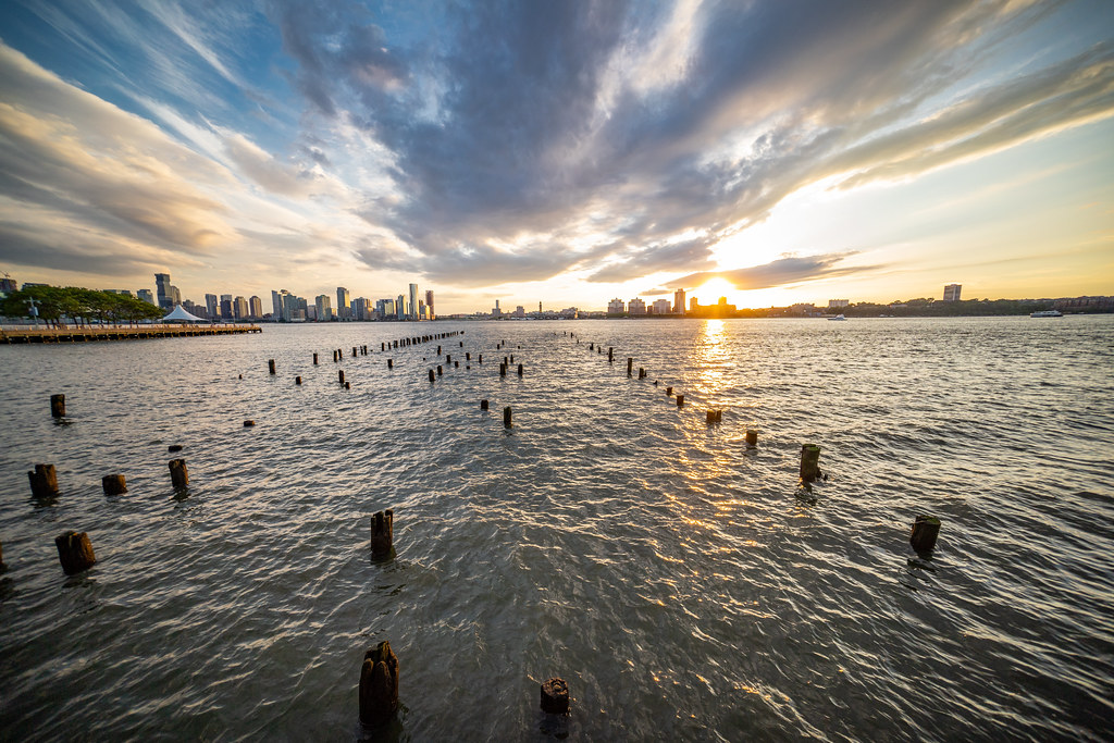 The sunset behind Jersey City from Pier 46 on Manhattan's West Coast.
