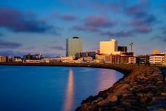 Sunset - Reykjavik City, Iceland (Páll Guðjónsson) Tags: bigstopper blue highrise iceland ndfilter reykjavik sea zeissdistagontf235mmze cityscape clouds eveningsunset golden longexposure outdoors reflection shoreline