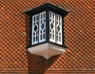 Tile-hung wall with lattice window