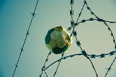 Game over ! (CJS*64) Tags: nikon nikkorlens 18mm105mmlens 18105mmlens nikkor nikond7000 d7000 dslr cjs64 craigsunter colour colours football fulltime ball fence razorwire pooped deflated