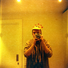 "reflected self-portrait with Empire Junior camera and lion hat (pho-Tony) Tags: cameraselfportraits redscale empirejunior 120 6x6 6cmx6cm rollfilm roll film haking hongkong ""bright – hazy cloudy"" mediumformat lomographyredscale lomo analogue analog ishootfilm medium format"