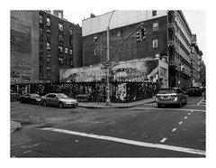 160514_1382_160514 162611_oly_S1_New York (A Is To B As B Is To C) Tags: aistobasbistoc usa newyorkstate newyork roadtrip travel olympus stylus1s bw monochrome blackwhite blackandwhite manhattan woosterst grandst soho city crossing street car carcity streetlight fence wall graffiti eye eyes urban cityscape corner lakotanorthdakota mural jr nativeamerican northdakota insideout pasteup