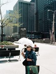 Old Lady with Umbrella at AMA Plaza (2) (shaundancekid) Tags: film portra 160 kodak nikon n65 color chicago ishootfilm filmisnotdead