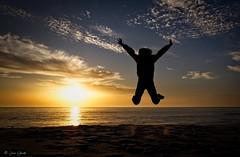 Leap of faith (Explored) (galavardo) Tags: olympus pen penf leicadgsummilux15mm17 lariño lacoruña galicia españa spain playa beach atardecer sunset mirrorless on1