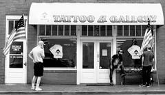 Indecisive (tvdflickr) Tags: georgia marietta usa street tattoo gallery men customers tattooartist indecisive patron male fujifilm x100f fujifilmx100f rangefinder urban city sidewalk storefront shop