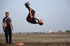 I believe I can fly... (Rahul Gaywala) Tags: dumas beach sea surat gujarat india candid casual life people action camel plane boy girl