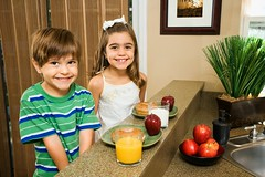 Stock Images (perfectionistreviews) Tags: 34years hispanic male child boy 79years female girl sister brother siblings children kids home indoors horizontal kitchen twopeople lookingatviewer eyecontact smiling sitting drink bagel healthy snack breakfast food portrait nutrition brunette cute eating happy lifestyle leisure photograph people color childhood youth smile happiness sibling halflength expression emotion domesticscene eat morning foodanddrink