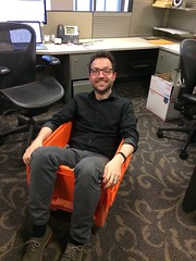 Each Tribune employee gets one orange moving crate to pack our stuff. It makes for a nice a lounge chair. (spudart) Tags: tribunetower chicago move moving orangecrate 60611 chicagotribune tronc tribunecontentagency office desk farewell goodbye goofingaround havingfun funatwork