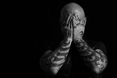 Why! (Andrea Gambadoro) Tags: red black white bw tattoo tattoos model friend shy laugh studio photography photographer man masculine hand hands bald male portrait