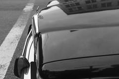 Mercedes 280E (Zach K) Tags: mercedes mercedesbenz 280e car auto vehicle parked brooklyn nyc ny crosswalk black hood reflection reflectors classic vintage mirror streets classy fujifilm fuji x100f acros curved metal sheetmetal