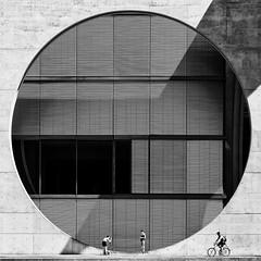 Wheels (Leipzig_trifft_Wien) Tags: berlin deutschland de architecture people square modern contemporary building city urban street black white bnw bw blackandwhite noiretblanc photographer model biker circle geometry decisive composition structure pattern