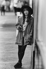 When Our Eyes Met (Ian Sane) Tags: ian sane images whenoureyesmet woman phone style hat leaning downtown portland oregon black white candid street photography southwest broadway canon eos 5ds r camera ef70200mm f28l is usm lens monochromemonday