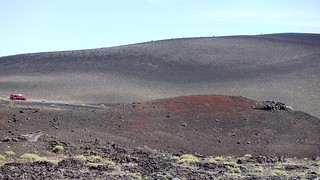 Barely visible hikers on Inferno Cone in Craters of the Moon National Monument & Preserve on the Snake River Plain in Central Idaho