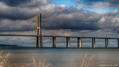 Lisbon, Portugal: Vasco da Gama Bridge crossing the Tagus River (nabobswims) Tags: aerialphotography bridge estuary hdr highdynamicrange ilce6000 lightroom lisboa lisbon nabob nabobswims pt ponte portugal riotejo sel18105g sonya6000 tagusriver vascodagama