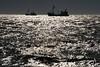 sunny waters (Wöwwesch) Tags: northsea sky boats fishing reflections ocean sea sun