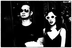 Hyperopia (Stephen Percival) Tags: blurred outoffocus highcontrast sunglasses street urban candid white oriental moriyama fujifilm xpro2