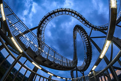 loops in the blue (Blende1.8) Tags: tigerandturtlethemagicmountain tigerandturtle magicmountain tigerturtle landmarke landmark fisheye bluehour ruhrgebiet ruhrpott nrw deutschland germany art sony walimex alpha ilce6300 a6300 8mm duisburg curvy curves blauestunde carstenheyer lines linien sky himmel wolken clouds cloudy bewölkt