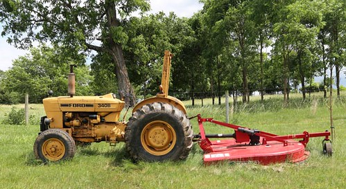 Ford 340B Tractor ($2,800.00) and Bush Hog ($1,736.00)
