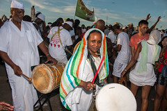 Drummer in the Crowd (Ifègbemìí) Tags: respect 26thannualtributetotheancestors newyork legacy africanpeople middlepassage brooklyn ancestors beach caribbean ma'afa coneyisland africandescendants unitedstates drummer whiteclothing americas
