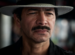 Colonel Luis Cruz [Stranger #81/100] (Vijay Britto Photography) Tags: man handsome hat cowboy 85mm 18 stern colonel seriou nikon d750 100strangers naturallight outdoorportraits