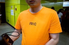 fric... (Damien Manspeaker) Tags: fric ricoh gr street photography china guangzhou travel adventure funny chinglish shirt yellow or maybe orange subway station metro bus transportation swear words word fuck chinese