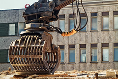 Excavator Bucket On A Demolition Site (k009034) Tags: 500px copy space finland oulu tranquil scene architecture big bucket building city debris demolition excavator iron machine machinery metal reflection street summer tool wall windows wire yellow teamcanon copyspace tranquilscene excavatorbucket