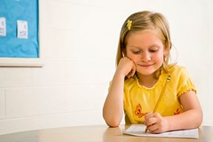 Stock Images (perfectionistreviews) Tags: 1 blond cheerful child class classroom concentration copyspace cute education elementaryschool female girl happy horizontal indoors inside kid knowledge learning one oneperson paper pencil person primaryschool pupil quiz school schoolwork sitting smile smiling student teach test waistup writing young color photograph childhood children