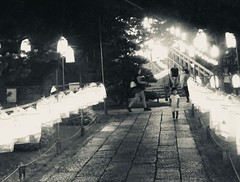 spooky. (framingthestreets) Tags: •blackandwhite blackandwhite streetphotography streetphotographer daidomoriyama streertart reality reallife livingthemoment captured framed japan kyoto spooky night lights moody kid child lantern lanterns cemetry ghost respect stairwaytoheaven stairway
