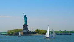 Lady Liberty (soboy5) Tags: statue nyc statueofliberty manhattan lowermanhattan newyorkcity newyork water architecture sailboats island libertyisland torch newyorkharbor fla flag blue green trees