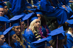 Glowing Graduate (aaronrhawkins) Tags: graduate highschool graduation girl teen teenager glow beautiful blond standout illuminate timpview provo utah orem utahvalleyuniversity robe cap gown regalia audience crowd bright bored boring attention stare ceremony peers isolate aaronhawkins woman young thoughtful contemplate think shine pretty glamorous cute blonde beam radiate spotlight emit centerofattention attractattention highlight obvious
