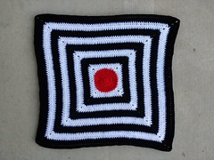 The granny square black and white striped baby blanket with a modest border ready to be blocked (crochetbug13) Tags: crochet crocheted crocheting crochetcircle crochetblanket grannysquareblanket crochetsquare grannysquare crochetstripes
