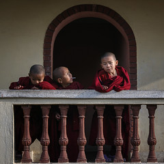 Buddhist monks stand on the balcony of monastery at Boudha Nath, Kathmandu, Nepal. (Tenzin Samphel) Tags: young kids buddhist stand balcony buddhistlover playing buddhafollower buddhalove tenzinsamphelphotography monastery gompa boudhanath stupa visitnepal travelnepal kathmandu nepal