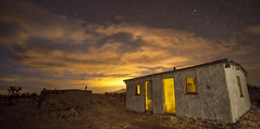 Passing Storm (magnetic_red) Tags: house old decay abandoned sky stormy clouds night stars drama dramatic light cabin desert mojavenationalpreserve