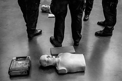 CPR (johnjackson808) Tags: healthcare vancouver dummy monochrome lesson training people defibrillator bw emt fujifilmxt1 blackandwhite streetphotography downtown