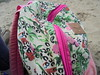 DSC04347 (classroomcamera) Tags: field trip trips backpack backpacks bag bags pink pattern patterns floral print prints flower flowers strap straps zip zips zipping zipper white red green design designs closeup