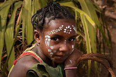 Painted Girl (Rod Waddington) Tags: africa african afrique afrika madagascar malagasy girl culture cultural child basket plant portrait people painted face outdoor