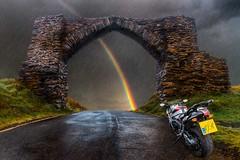 Chasing the Rainbow (bainebiker) Tags: rainbow sky monument road forbodingsky canonef24mmf1411usm rain jubileearch bmwk1300s pontarfynach powyceridigion walesuk relic structure stonework