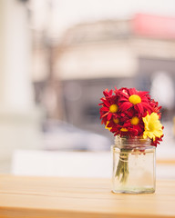 Have a great week! (ninasclicks) Tags: flowers vase table street streetphotography red yellow bokeh dof