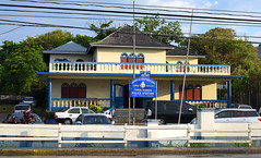 Jamaican Police Station (Anthony Mark Images) Tags: road whitefence cementpartition policestation jamaica westindies caribbean jamaicanpolice cars hydrowires pastelyellow