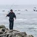 Fisherman walking on the rocks at Moss Landing