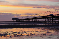 Southport Sunset (JamieHaugh) Tags: southport liverpool merseyside england uk gb great britain outdoors sony a6000 sunset evening dusk pier pink purple sand beach coast seaside sea water sky clouds peace quiet reflections ilce6000 zeiss orange structure seascape color colour