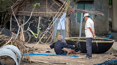 Hoi An - Bamboo Boat Builder (Gilama Mill) Tags: asia landscapes people travel vietnam water man boat hoi an hoian biulder craftsman
