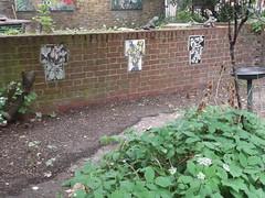 24th May 2018 (themostinept) Tags: tiles design mosaic brickwall cromerstreet london wc1 camden bloomsbury garden gardenornaments gardenforpeace cromerstreetgardenassociation