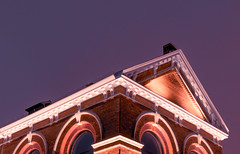 Cornhill Stronghold (C. E. Kingsley-Jones) Tags: nikon d7200 35mm 18g lincoln cornhill exchange stronghold night nighttime sky purple orange building bricks roof urban city architecture temple greek arches pillar triangle glow contrast colour