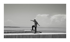 up and down (giovdim) Tags: street skate skating people man balance sea geometry monochrome greece skater posing