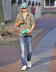 IMG_2068 (Skinny Guy Lover) Tags: outdoor people candid guy man male dude skinn veryskinny slender veryslender cap hoodedjacket jeans bluejeans smartphonezombie handsome walking
