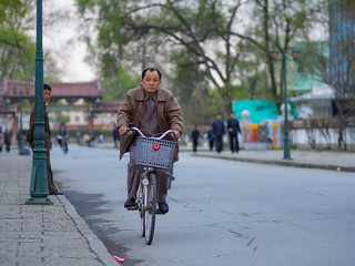 Cyclist on Sariwon Folk Customs Street, North Korea